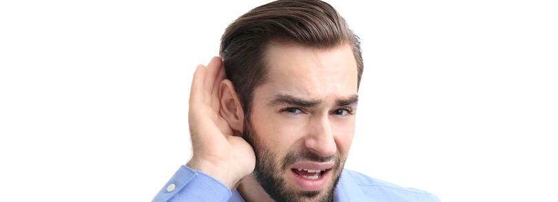 Man with hand to his ear