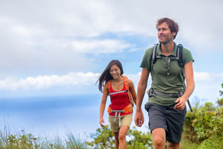 two recovering addicts on a hike together to avoid relapse triggers