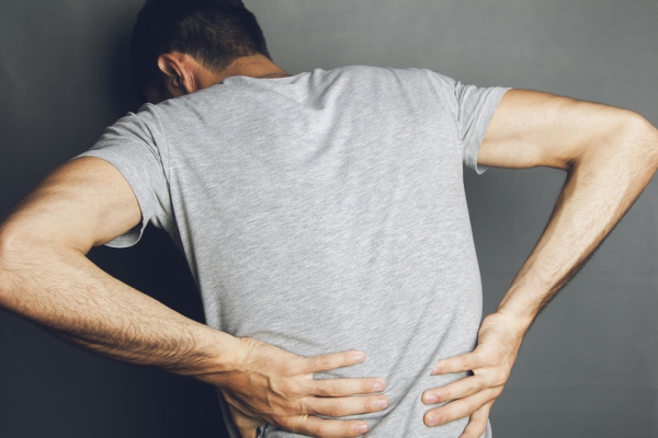 A man experiencing back pain