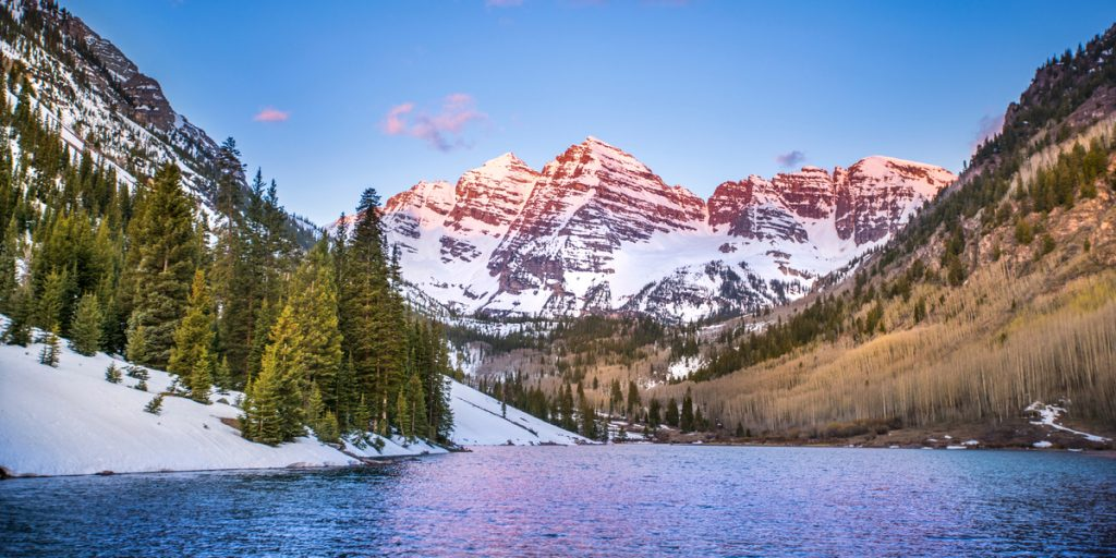 Snowy mountains along a river in aspen co