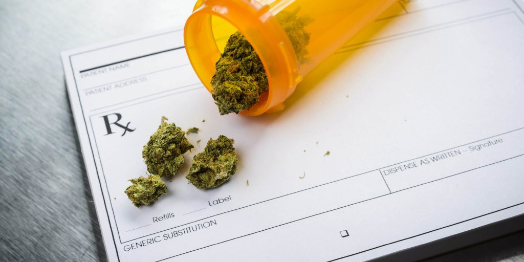 A doctor leaves marijuana on a prescription form for pain